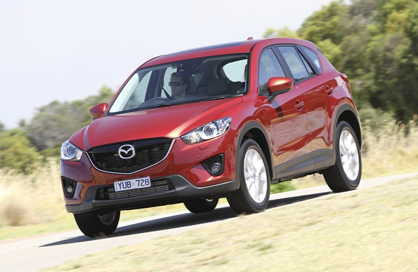 2012 Mazda CX-5 AWD SUV front driving dirt