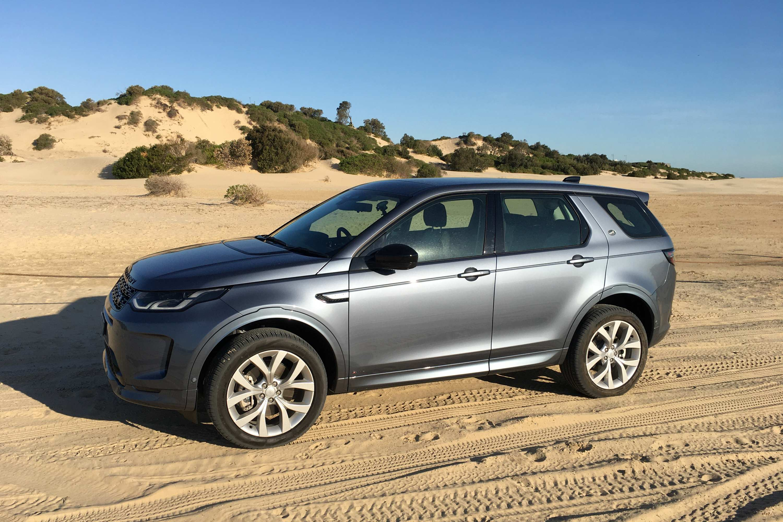 2021 Land Rover Discovery Sport R-Dynamic SE driving sand 2